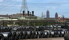Coils of steel product await transportation at ArcelorMittal Cleveland, photographed on Wed., August 24, 2016. The downtown skyline is in the background(Thomas Ondrey/The Plain Dealer)