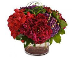 Red roses, burgundy dahlias, purple hydrangea.