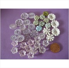 lot of fancy buttons in whites, clear pale green etc on eBid United Kingdom