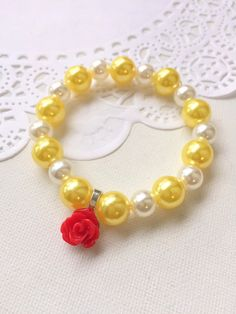 Beauty and the beast inspired, Kids birthday party favor, red rose bracelet, beaded bracelet, jewelry favor, childrens bracelet. Set of TEN. ************************** Party planning is already so stressful. Leave the favors up to us! This listing is for (10) child sized bracelets. DETAILS and MEASUREMENTS: Beads vary in sizes from 6mm-10mm. The length of a bracelet is 6.5 (we can make them smaller or bigger for you). COLOUR & CHARM CHOICES: If the bracelet does not match your party ...