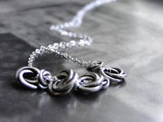SPRING SALE - Knotted Ring Necklace, Boho Chic, Sterling Silver Statement Necklace on Etsy, $37.00