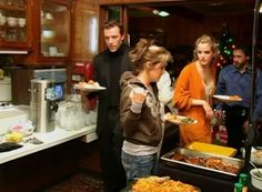 LMP in the kitchen with her family after tour hours are over.