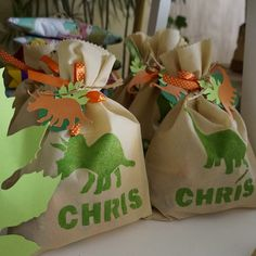 Treat bag paper sack with stamped dino foot and name