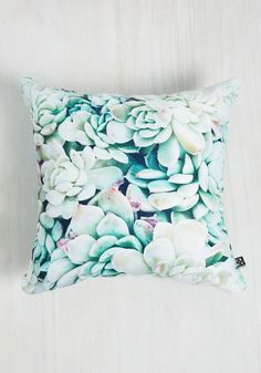 Bring the beauty of nature into your flat by adorning your sofa with this printed pillow by Chelsea Victoria for DENY. With a photorealistic images of ghost plants in icy green and purple hues, this fantastic throw adds standout style to your spaces.
