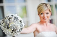 This white bridal bouquet accented with brooches is simply divine #Disney #wedding #brooch #bouquet