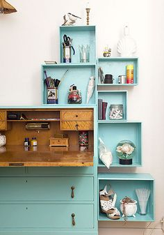 Love the style of the desk, the lovely aqua (especially against the wood), and the creative addition of boxes for storage and display