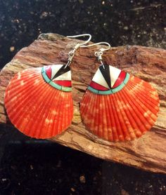 A personal favorite from my Etsy shop https://www.etsy.com/listing/564409823/native-american-jewelry-orange-scallop