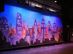 Joe & Gena want a skyline of buildings painted on at least one wall in the baby's room Elf The Musical, Annie Musical, Bristol, City Backdrop, Ny Skyline, Laser Tag, Jobs In Art, Set Design Theatre, Church Stage Design