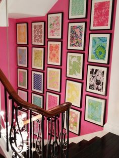 patterned cloth/paper framed and tiled on a wall.. love