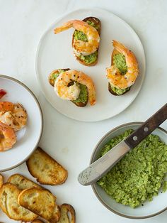 Favetta crostinis topped with smoky sautéed shrimp