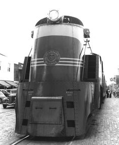 Nose view of locomotive 868 as passengers board in 1940 by TPavluvcik, via Flickr