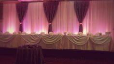 Chiffon Backdrop with Silver Ruffle Panels synched in middle with sash (silver & pink) #yyceventrentals #wedding www.greateventsrentals.com
