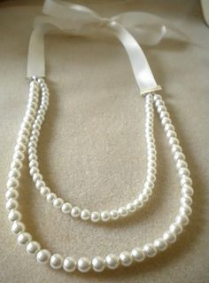 A classy ribbon and pearl necklace tutorial. This is just so Southern, so lady-like, and preppy. It's just so me.