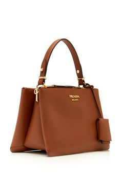 Prada's Borse handbag oozes classic style, with a structured, rectangle shape and top handle for easy hand carrying. Stylish and durable leather make the main of the bag whilst essential Prada metal details complete the bag. Great for everyday. Popular Handbags, Best Handbags, Cute Handbags, Cheap Handbags, Cheap Bags, Black Handbags, Luxury Handbags, Fashion Handbags, Purses And Handbags