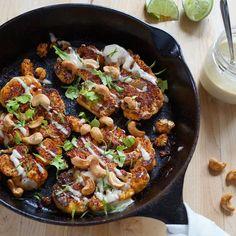 Chili-Lime Cauliflower Steaks with Coconut Tahini Sauce & Cashews 1 large cauliflower 1 tbsp olive oil 1 Tbsp chili powder Zest of 1 lime 1 tsp lime juice 1/3 cup toasted cashews ¼ - ½ tsp salt