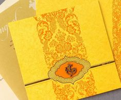 Yellow colour wedding invitation in Indian Ganesha theme. The invite is rich in colour and design and comes with two inserts. Ganesha logo can be replaced with name initials or any other faith symbol. Indian Wedding Invitation Cards, Wedding Invitation Card Design, Indian Wedding Cards, Classic Wedding Invitations, Wedding Card Design, Invite, Wedding Posters, Yellow Wedding, Faith Symbol