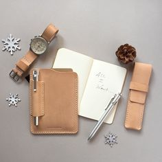 Items to help record your thoughts, dreams, designs and ideas. Our handsome new handcrafted leather notebook and pen sleeve, our single pen holder and a fabulous matching nato strap. BAS AND LOKES