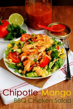 Chipotle-Mango BBQ Chicken Salad is grilled chicken slathered in homemade chipotle-mango BBQ sauce then grilled to perfection and served atop crispy, cold greens. | iowagirleats.com