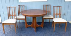 Broyhill Brasilia Dining Set  Gorgeous mid century modern dining set from the Broyhill Brasilia line includes a round dining table with 3 leaves