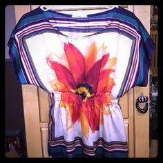 Floral Blouse Short sleeved blouse with stretchy waistband and big flower in the center. Missing a strand of elastic in the waste pictured above. Papaya Tops Blouses