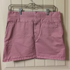 """Old Navy pink mini skirt khaki size 6 EUC Excellent condition! Light rose Pink skirt. Dress it up or down. Great for business or casual. Measures approx 15-15.5"""" straight across waist and approx 14.5"""" length. Has two back pockets that button down, two front pockets and a coin pocket. Zips and hooks in the front. 100% cotton. Old Navy Skirts Mini"""