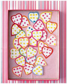 super easy valentine- sheets of candy dots cut into heart shape with construction paper glued on the back. Could put it in a glasine bag to pass out at school/daycare.