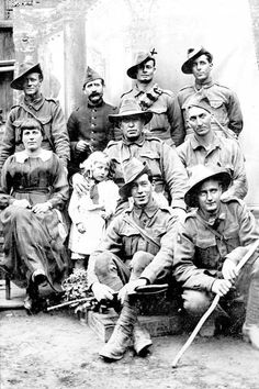 Australian soldiers pose with members of a French family on whom they were billeted, c.1916–18. [AWM H12920]Image 5 of 9