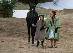Little House on the Prairie Laura Ingalls leads her horse Bunny while walking with Nellie Oleson