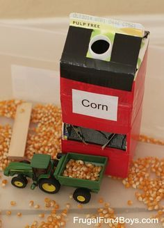 """Grain silo"" for farm sensory bin/ tractor loading. Made with milk container, cereal box and duct tape"