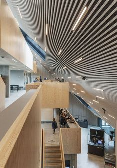 COBE's funnel-shaped Tingbjerg Library and Culture House acts like a single facade in Copenhagen