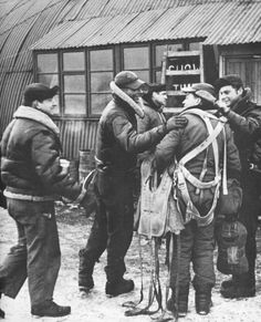 US Airmen congratulating each other on arriving safely back after a raid