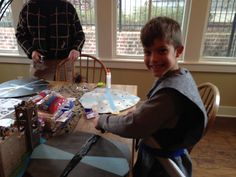 Boys' knight birthday party activity: decorate your own cardboard shield with colored duct tape Medieval Party, Knight Party, Party Activities, Old Boys, Birthday Parties, Kid Parties, Year Old, Party Themes, Fun