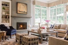 If you have a fireplace off to one side, consider one lounge chair to the side while creating a corner with sofas opposite the chair. This creates visual symmetry. Notice the great game table in the corner that sits in the window with all the glorious sunlight.