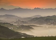 Mist rises as the sun sets on San Vicente de la Barquera, one of Cantabria's many picturesque towns.Cantabria's is Lone