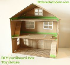 A cute toy house / doll house made of recycled cardboard boxes. Easy DIY project!