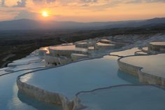 """Pamukkale, meaning """"cotton castle"""" in Turkish, is a natural site in Denizli Province in southwestern Turkey. The city contains hot springs and travertines, terraces of carbonate minerals left by the flowing water. Top Places To Travel, Ways To Travel, Places To Go, Awsome Pictures, Pamukkale, Rock Pools, Top Destinations, Cover Pics, Science And Nature"""
