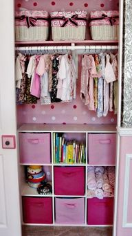Excellent way to organize a babys closet using a small bookshelf, inexpensive baskets, and matching collapsible storage containers.