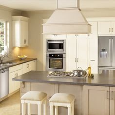 Like range hood over island. Like back wall with micro, wall oven, pantry and refrigerator. Would work for our house design.