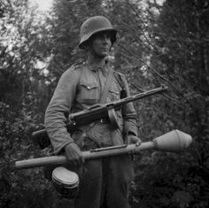 Summer soldier with Suomi 31 submachine and german Panzerfaust