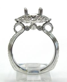 Eduardo Escudero's custom diamond semi-mounting. Mounting is 14kt white gold and weighs 5.11 grams. Ring is set with 56 brilliant round cut diamonds and 2 marquise cut diamonds weighing .90ct total weight. Mounting is made for a 1.25 to 1.50ct center stone. This is a custom made one of a kind piece.