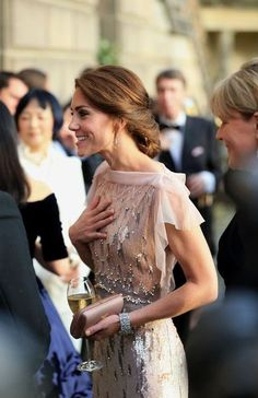 Kate Middleton Satin Clutch - Kate Middleton paired a dusty-rose satin clutch by Prada with a Jenny Packham rewear for the gala dinner supporting East Anglia's Children's Hospices.