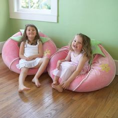 """This super soft """"Giant Strawberry"""" bean bag chair is perfect for relaxing or reading. She'll run to her Pink Strawberry Bean Bag when it's story time. Removable washable cover."""
