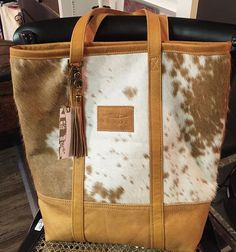 OBSESSED with these new, cowhide bags we got it Each one is so unique and soft! It's an understated yet stylish look that will go with every outfit!