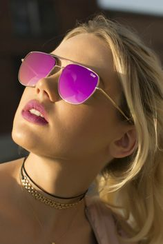 Gold framed sunnies with a pink lens. - Metal Frame - Polycarbonate Lens - Stainless Steel Hinges - Cat.3 Lens - 100% UV protection Care Instructions: Don't just throw these in the bottom of your bag.