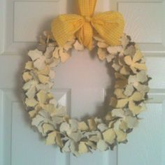 Paint paper egg cartons, cut cups apart, tear each side of cup almost to center, and hot glue to a wreath form. Add a bow and ta-da! ...a darling, easy, and super-inexpensive wreath.