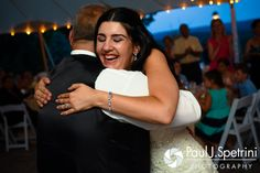 Lauryn hugs her father during her July 2016 wedding reception at the Overlook at Geer Tree Farm in Griswold, Connecticut.To see more photos from Justin and Lauryn's wedding, please visit http:// www.tinyurl.com/JustinAndLauryn (Copyright 2016: Paul J. Spetrini Photography)
