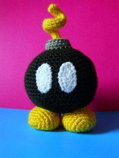 Bob-Omb inspired by Super Mario Bros Crochet Geek, Crochet Gifts, Crochet Dolls, Knit Crochet, Mario Crafts, Geek Crafts, Super Mario Bros, Bullet Jewelry, Geek Jewelry