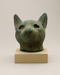 Head of cat coffin Period: Late Period–Ptolemaic Period Date: 664–30 B.C. Geography: Country of Origin Egypt Medium: Bronze