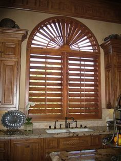 """Beautiful 5 ½"""" louvered Alder wood shutters in Kitchen at the Bridges in Rancho Santa Fe, CA. www.sandiego-shutters.com"""
