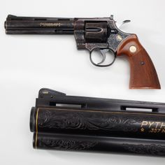 """Colt Python - We've found from past experience that any of the Colt """"snake guns"""" are always a crowd pleaser for our GOTD. Here's something special to keep up the """"buzz."""" But here's a little different Python with some refined gold wire inlay in addition to the engraving. On this one, it's easy to also note who completed the elegant scrollwork by just looking at the front sight. Signed in gold – A(ngelo) Bee. At the NRA National Firearms Museum in Fairfax, VA"""